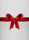 Red bow on white