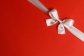 White bow on red