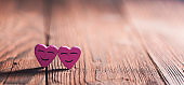 Two pink smiling hearts