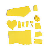 various pieces of torn yellow cardboard isolated on white background