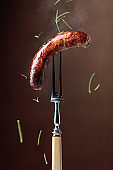 Grilled Bavarian sausage with rosemary.