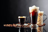 Coffee drinks and coffee beans on black background.
