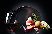 Red wine with prosciutto, pears and rosemary.