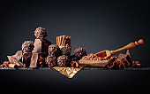 Chocolate truffles with broken pieces of chocolate and spices.