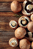 Fresh brown mushroom mushroom on an old wooden table.