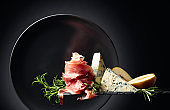 Prosciutto with blue cheese, pears and rosemary.