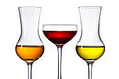 Glasses of different alcoholic drinks isolated on a white background
