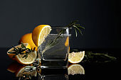 Cocktail gin-tonic with lemon rosemary.