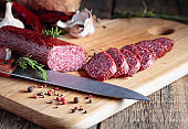 Salami on a old wooden table.