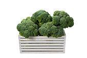 Fresh tasty broccoli in wooden box isolated