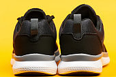 Back view of black sport shoes