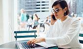 Focused businesswoman working on laptop