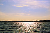Calm lake in the sunshine with a cloudy sky