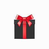 Realistic black gift box with red ribbons over white background. Christmas design vector illustration