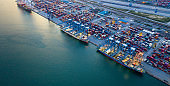 Aerial view Container ship at industrial port in import export business logistic and transportation of international by container ship, Container loading in cargo freight ship industrial crane.