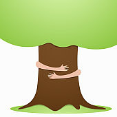 Go Green concept with hands hugs growth tree over white. Environment saving concept