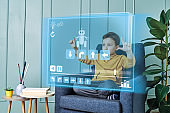 Futuristic child programming robot on virtual screen.