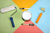 Repair tools on a multi-colored painted background. Shop banner, geometry. Minimal renovation and construction concept. Top view, place for text.