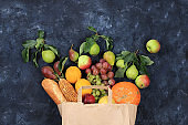 Healthy natural food in eco bag, healthy lifestyle concept, zero waste. Food delivery, donation. Vegetables, wrapped fruits,