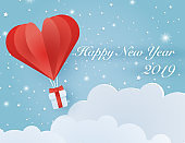 Origami made hot air balloon flying on the sky with heart float on the sky.
