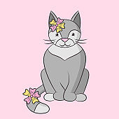 Beautiful cute gray cat with flowers on its head and tail