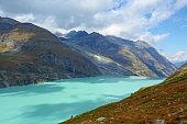Mountain lake Mattmark ( Stausee Mattmark) in Saas Valley surrounded by glaciers next to Zermatt, Switzerland