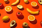 Beautiful fruits and vegetables on a bright background with hard shadows.