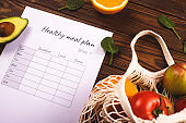 A table with a weekly nutrition plan. The concept of healthy eating and losing weight.