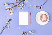 wish list for future plans. flat lay composition with flowers,notepad and coffee