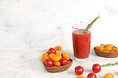 Tomato juice and ingredients on a concrete table. The concept of detox diet and weight loss, natural nutrition, healthy and natural foods. Summer drinks