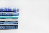 Clean garment neatly folded after laundry over bright background