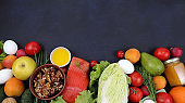 Vegetables, fruits and red fish on a dark background. The concept of healthy and natural food for weight loss, lifestyle, detox diet, keto diet, the purpose of which is to exclude carbohydrates,