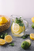 Citrus lemonade in glass jur. Mojito with lemon, lime and mint