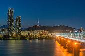 "Korea,Seoul at night, South Korea city skyline at Dongjak Bridge Han river in Seoul , South Korea.""n"