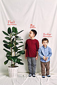 Cute child measuring his height. Growth and competition concept.