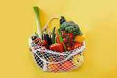 Eco friendly shopping bag with various fruits and veggies.