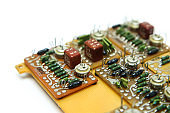 The old vintage circuit board with several electronic components.