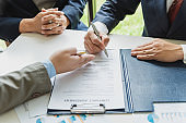 Businessman sign the contract, the agreement in the document.