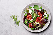 Beetroot salad with orange, cheese and mix of nuts, pumpkin seeds