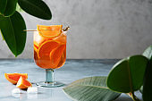 Aperol spritz cocktail with oranges and ice in wine glass