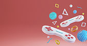 3d rendering gamepad, game console and icon hanging on a pink background. Gaming concept.