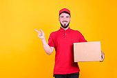 Young man with perfectly groomed beard delivering a package.
