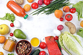 Vegetables, fruits and red fish on a light background. The concept of healthy and natural food for weight loss, lifestyle, detox and keto diet, the purpose of which is to exclude carbohydrates,