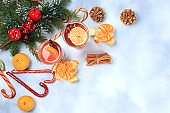 Winter composition, Alcoholic or non-alcoholic cocktail of tangerines, oranges and cinnamon with spices, warming winter drink in the cold season, Christmas festive grog,