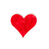 Red crumpled heart isolated on white background