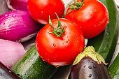 Ratatouille fresh ingredients: eggplant, onion, zucchini, tomato