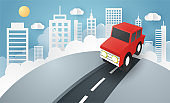 Escape from the city, illustration of love travel day, paper art of red car jumping on mound with the city at back, vector paper art and craft style.