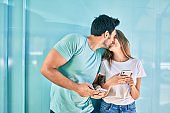 Young couple of boyfriend and girlfriend together using smartphone