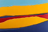 Layers of multicolored torn textured paper as creative background