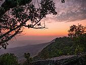 Beautiful Sunset at yeabmek Cliff on Phu Kradueng mountain national park in Loei City Thailand.Phu Kradueng mountain national park the famous Travel destination